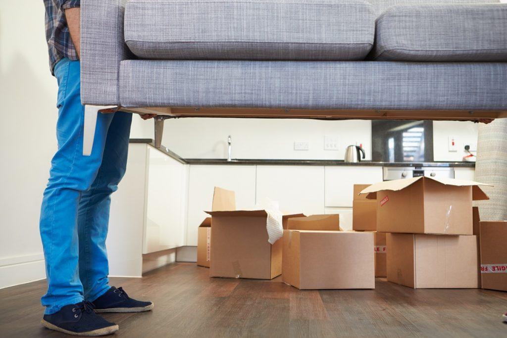 Man carrying a sofa