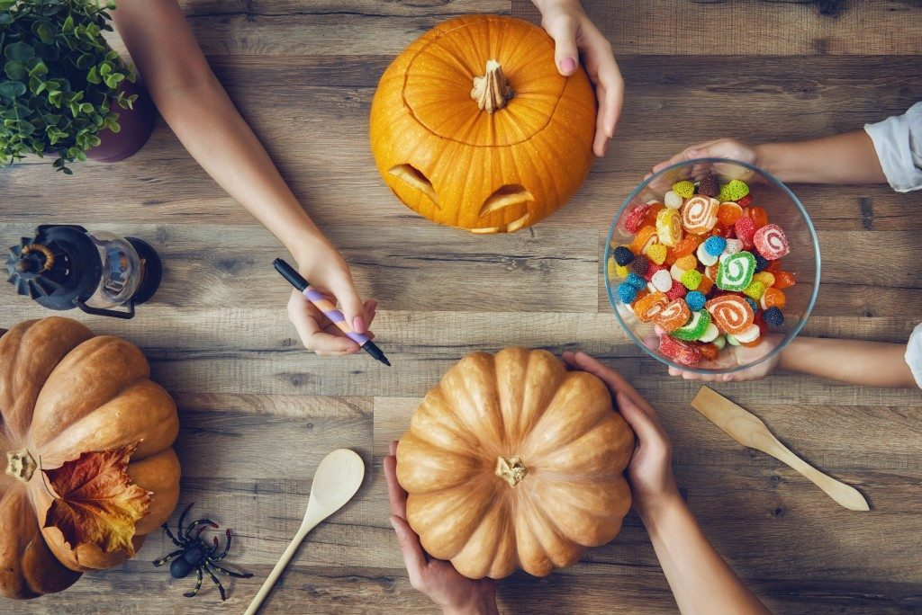 Carving pumpkins on a table