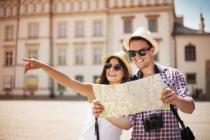 Tourists navigating the city with a map