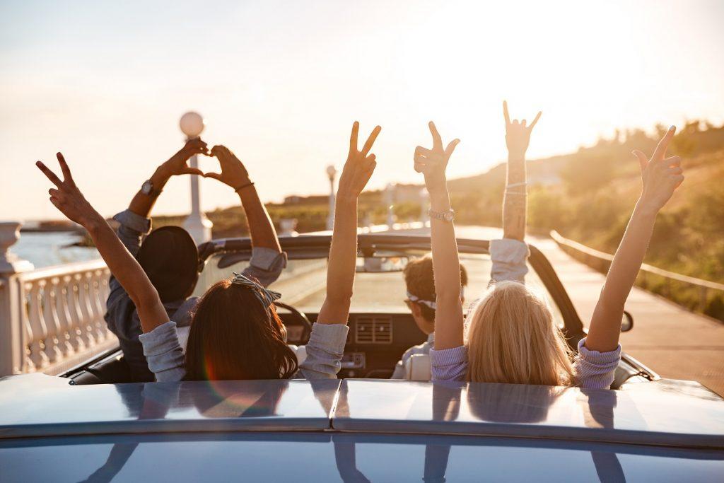 Group of friends enjoying a car ride