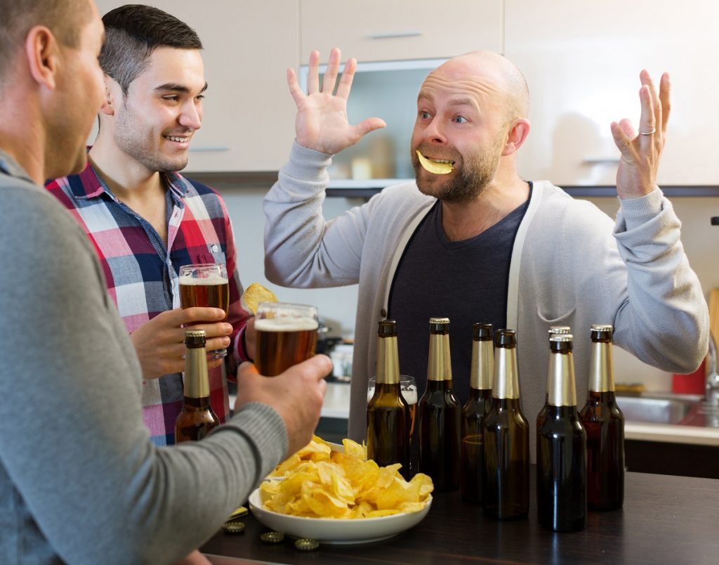 Men playing a drinking game