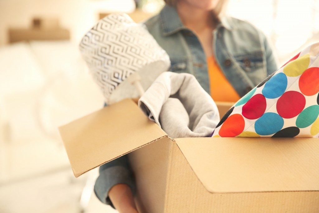 Woman holding an open box