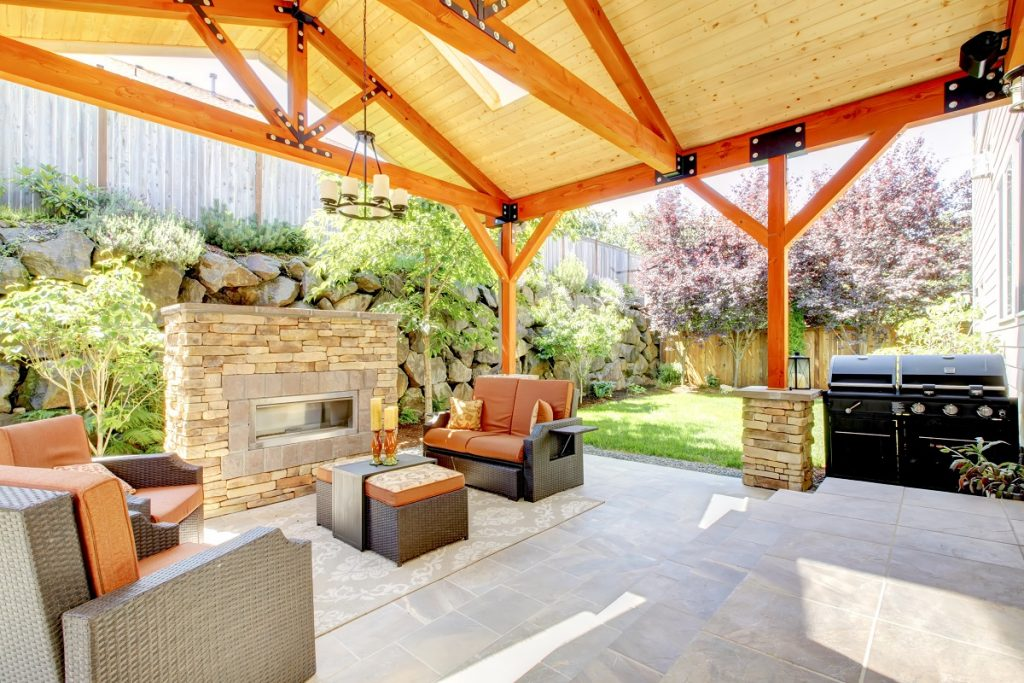 Covered patio with a fireplace