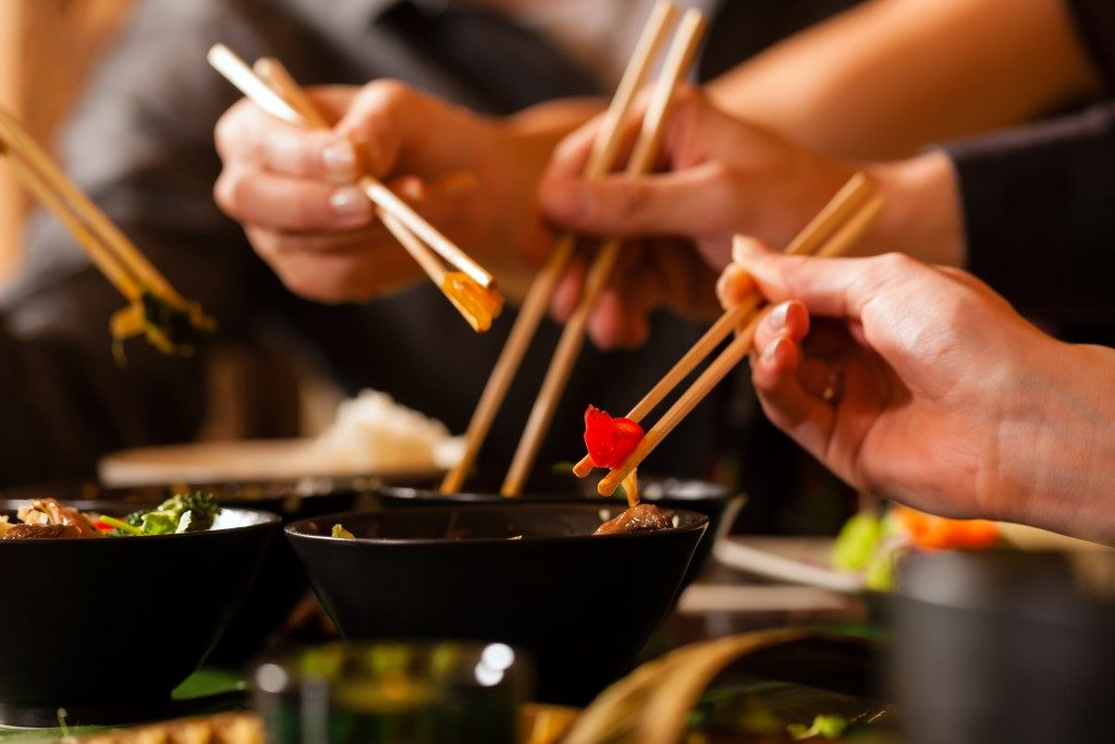 People eating with chopstick