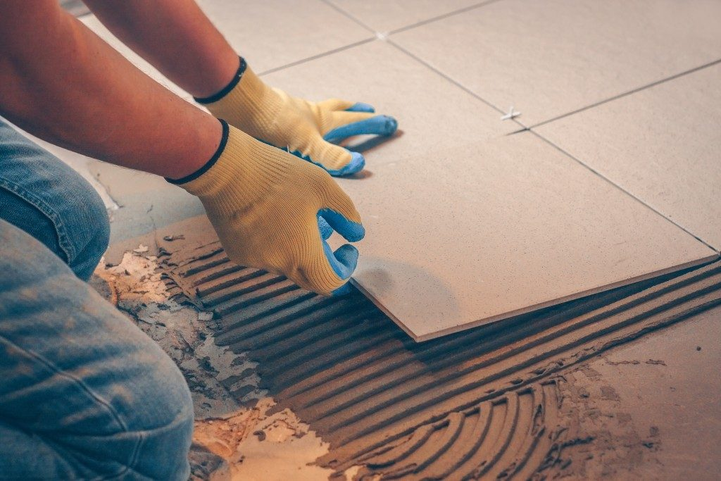 Man placing tiles