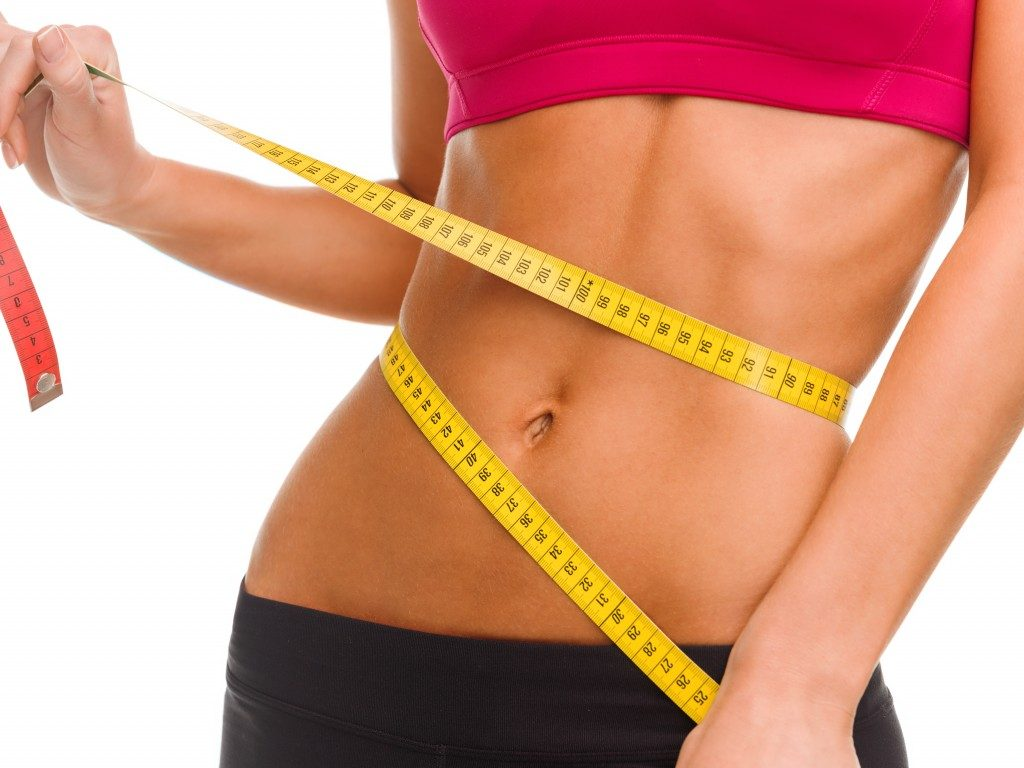 flat belly with measuring tape