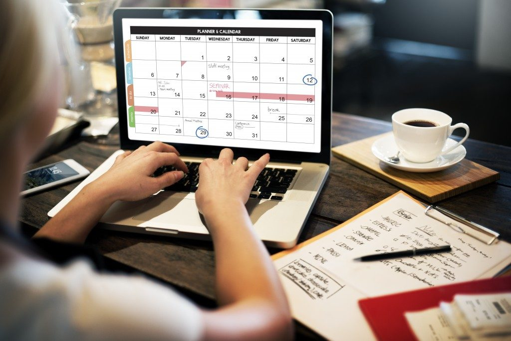 Woman checking calendar on laptop