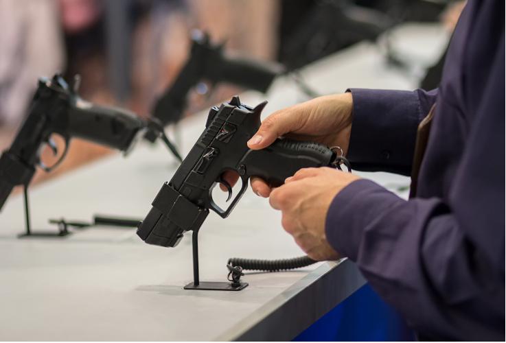 man trying a fake gun
