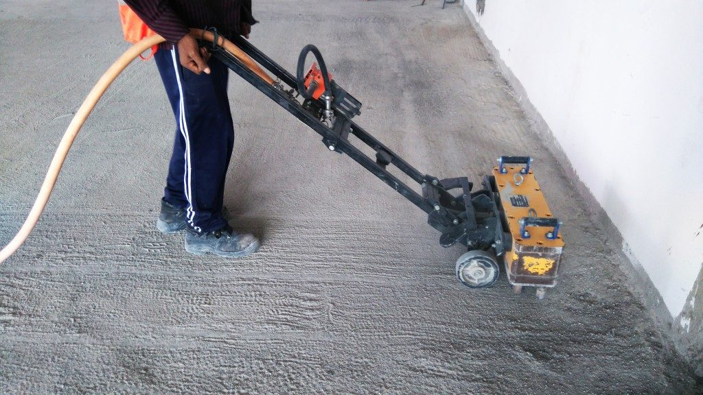 construction worker making concrete floor