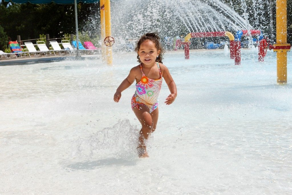 child enjoying summer at a water park