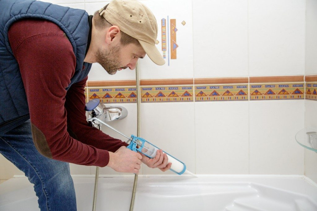 man installing a bathtub