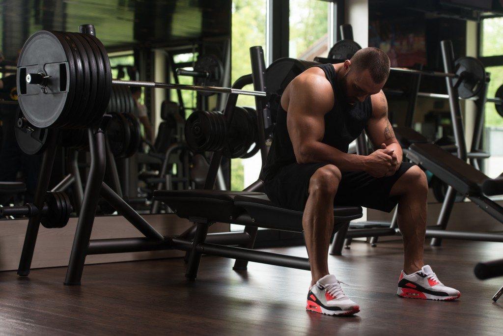 Bodybuilder resting on a bench
