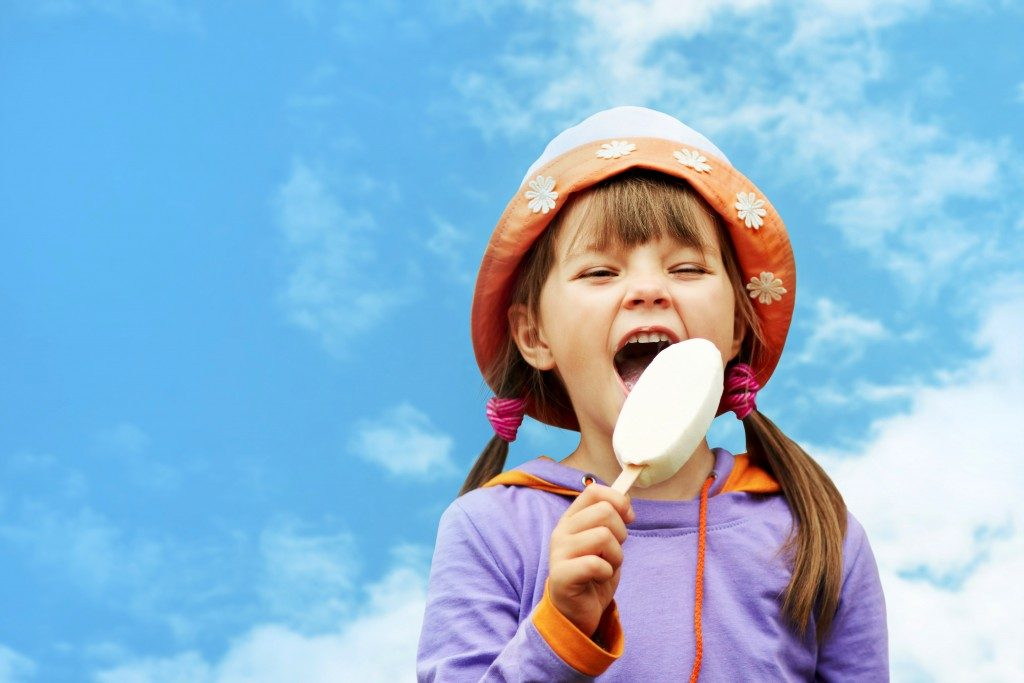child eating a popsicle