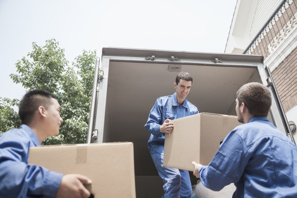 workers loading boxes in moving van