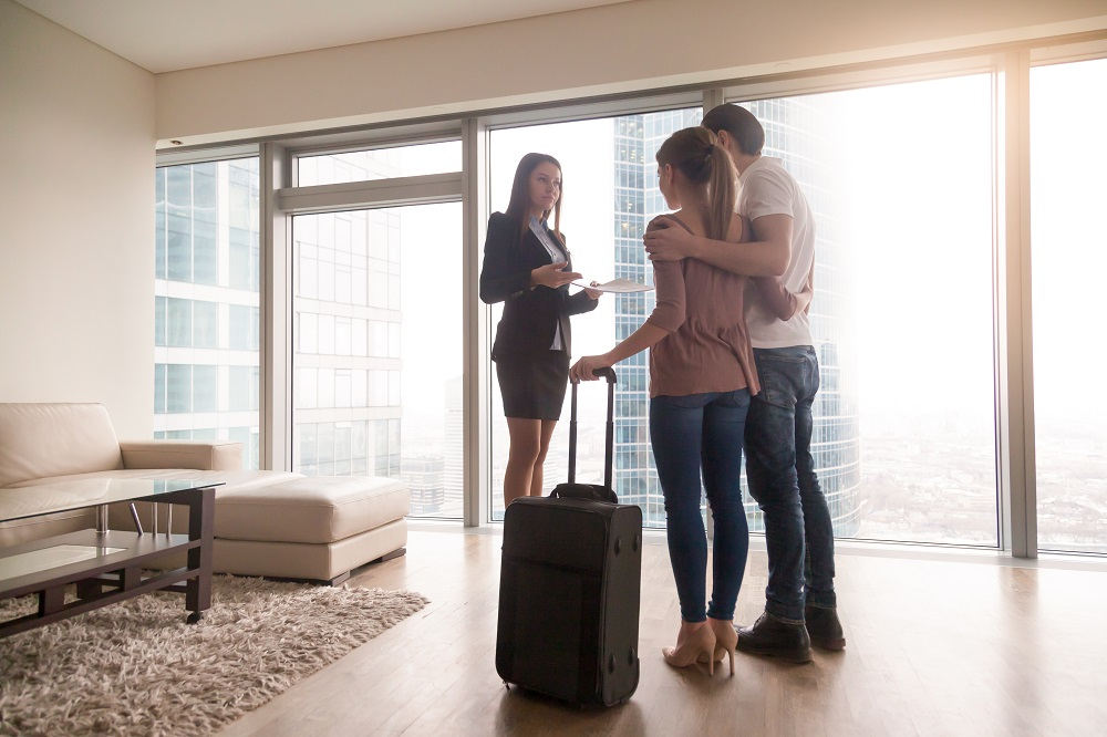 property manager showing unit to couple