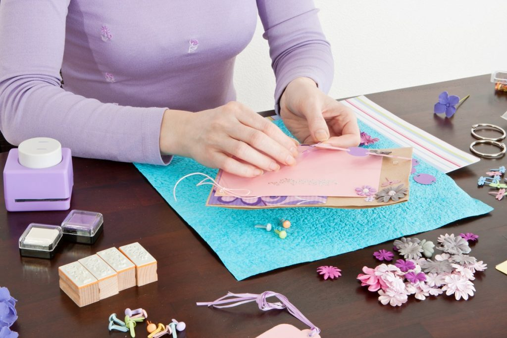 woman making cards