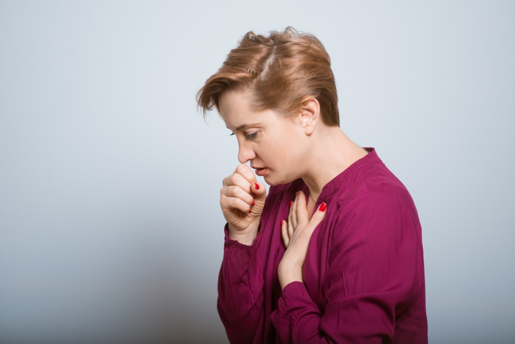 woman having a hard time coughing