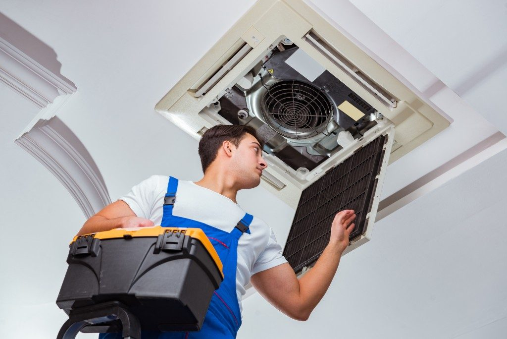 repair man fixing the aircon