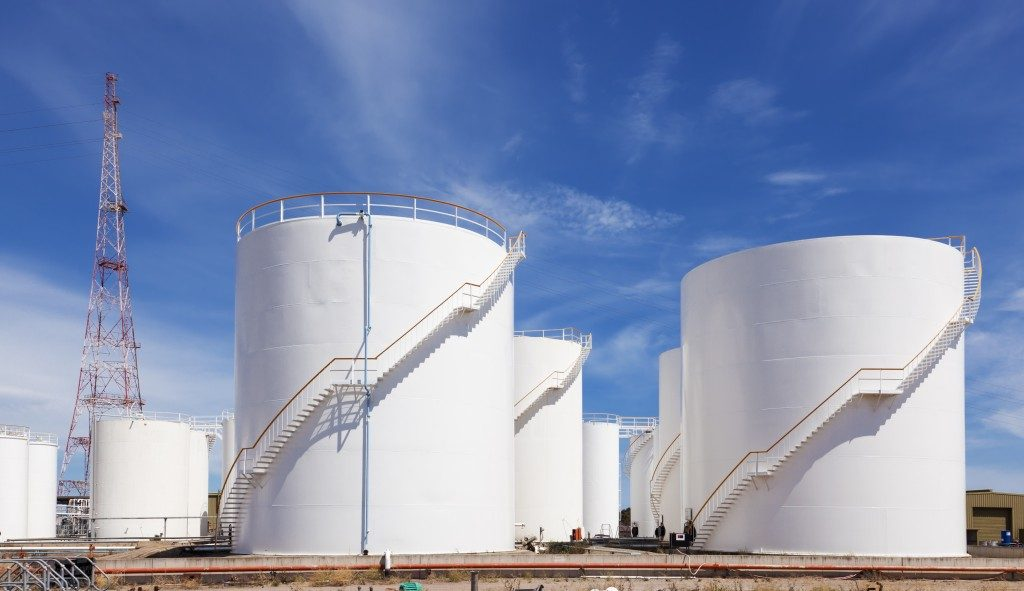 Fuel storage tanks against blue sky