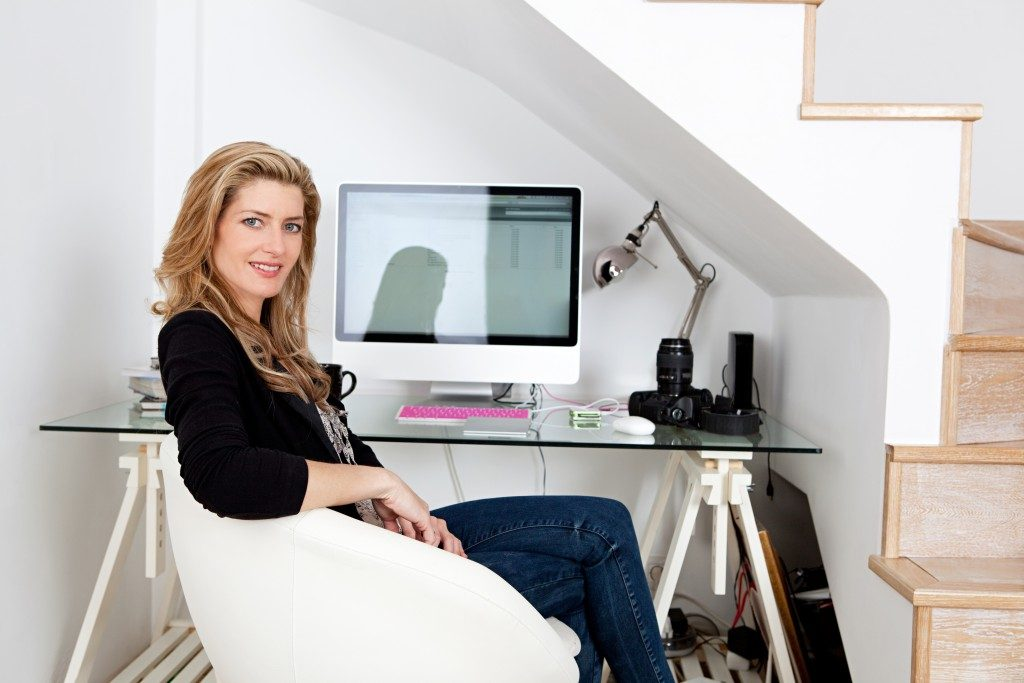 Phtographer working in her desk at home