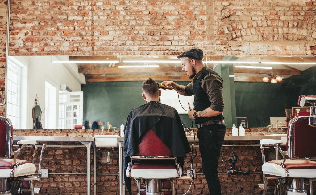 Man having haircut
