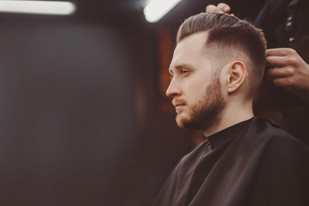 man having his hair trimmed
