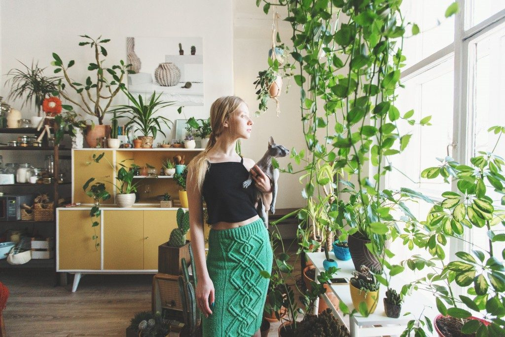 woman surrounded by plants