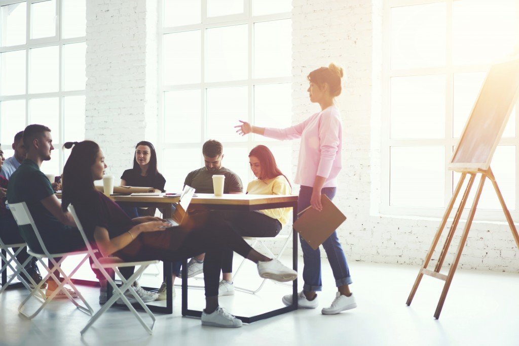 employees having a meeting in a big meeting room
