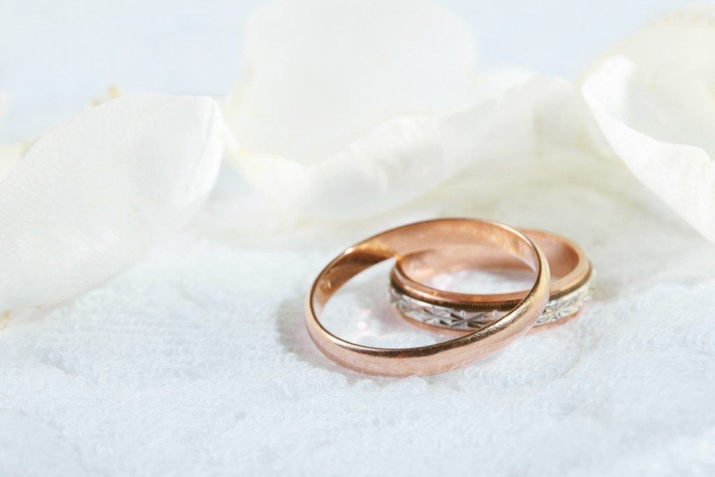 wedding rings on white cloth