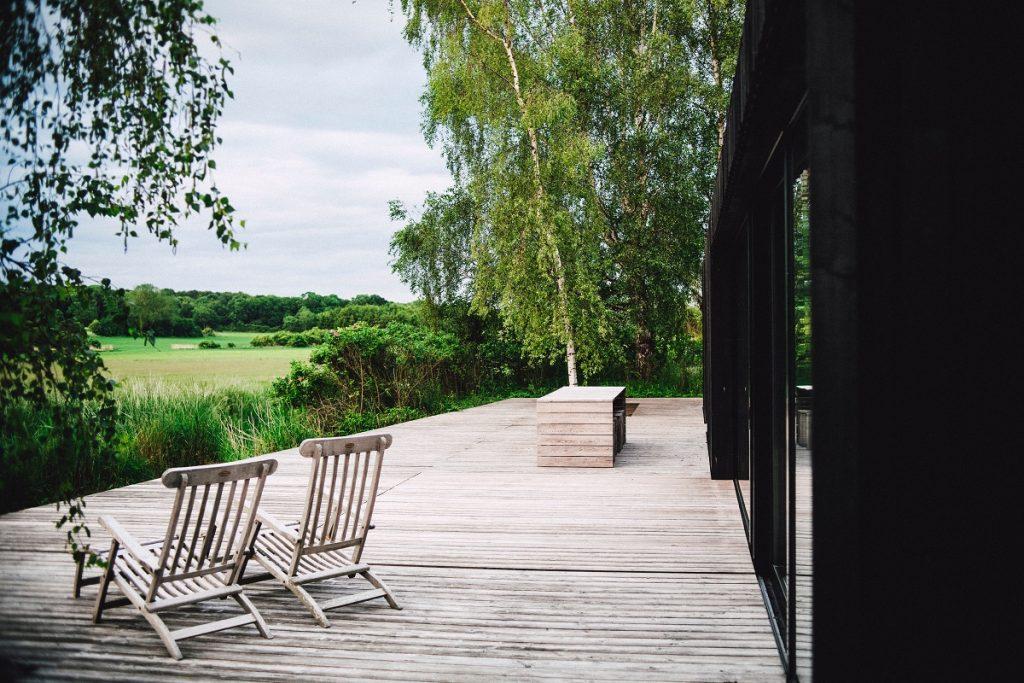 beige outdoor chairs in deck