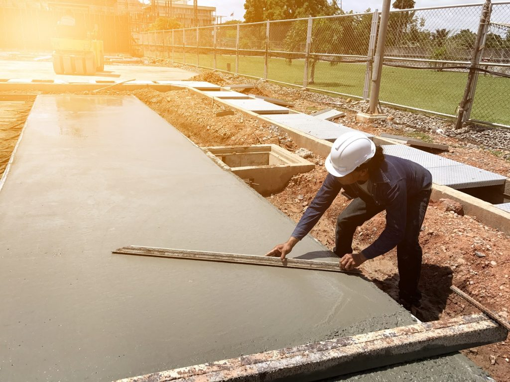 Man laying and leveling cement