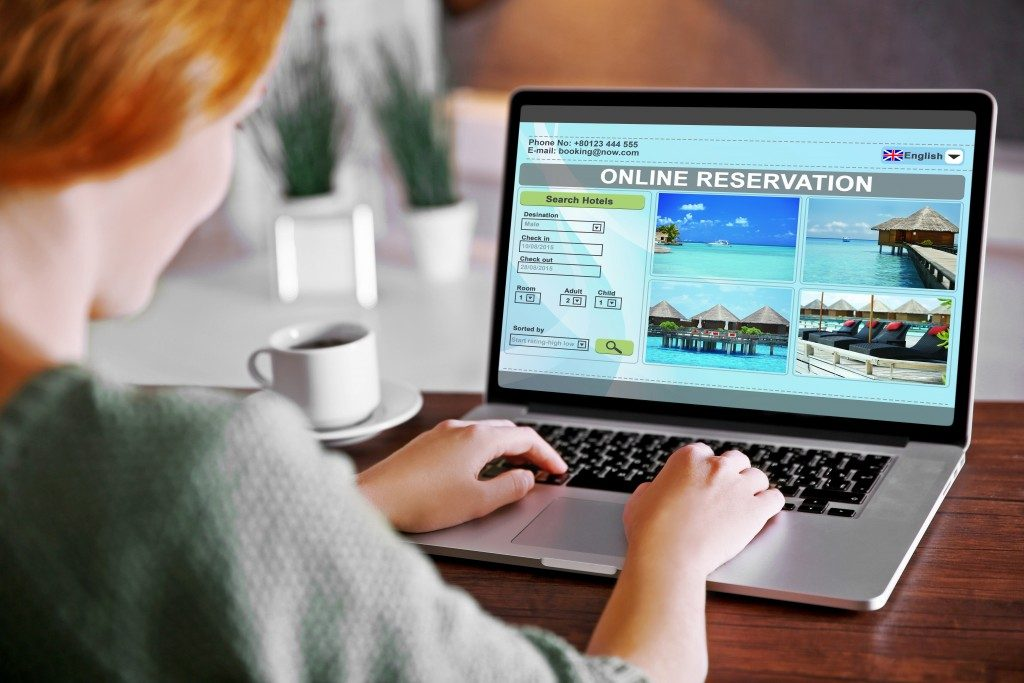 woman booking a hotel accommodation online