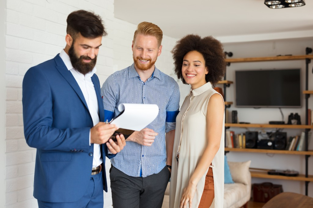 new home owners with real estate agent