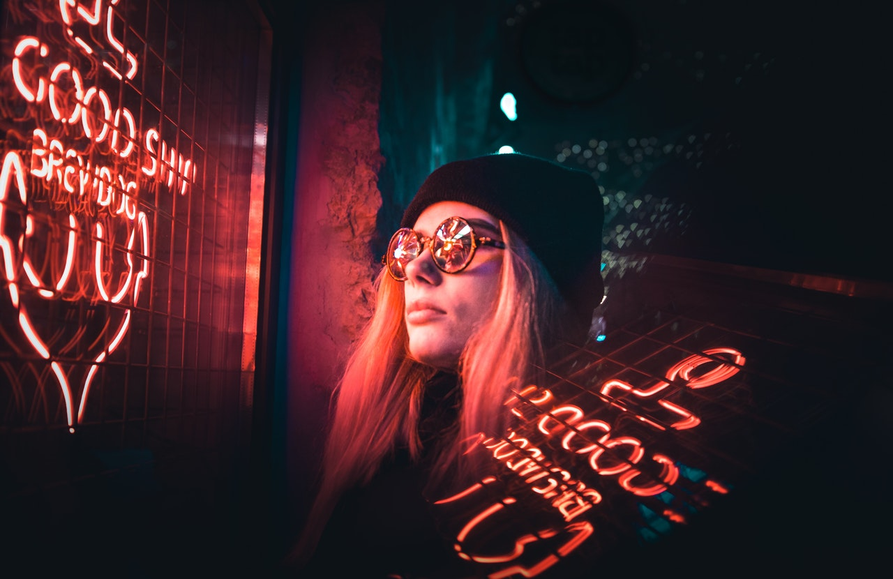 woman looking at neon sign